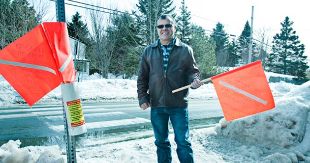 Brian Slaunwhite is one of the citizens helping install crosswalk flags in Halifax. - LENNY MULLINS