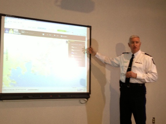 Deputy police chief Bill Moore demonstrates how to use the new crime mapping website for reporters.