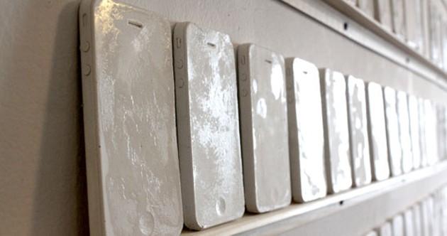 Dixon's wall of plaster iPhones. - HEATHER RAPPARD