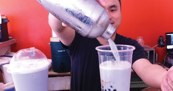 George Xiu serves up bubble tea---milky, sweet, with a chewy treat. - KYLE SHAW