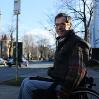 Gerry Post waits at a bus stop at the corner of Inglis and South Park.