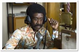 Hey Mr. DJ Don Cheadle rocks the puffy hair and shiny shirt in Talk to Me.