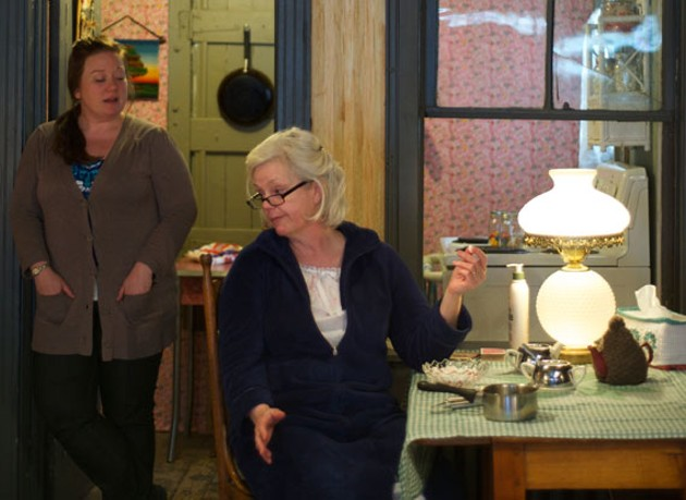 Jennifer Overton (sitting) and Lita Llewellyn star as family in 'night Mother. - RACHEL CHISHOLM