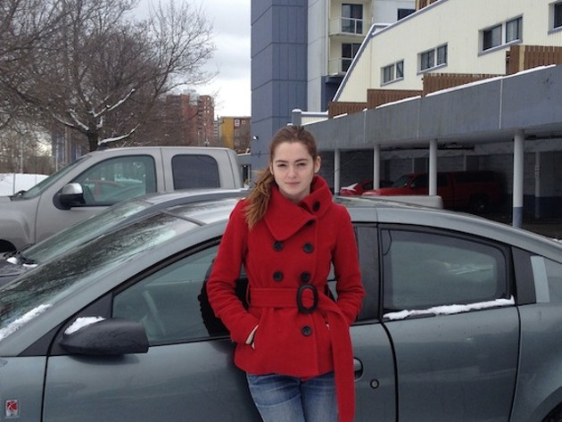Jenny MacDonald and car (parking notice not included; new permit parking-only signs are non-existent)