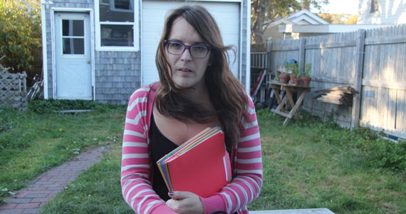Jessica Dempsey clutches her growing file of court documents - NATASHA MACDONALD-DUPUIS