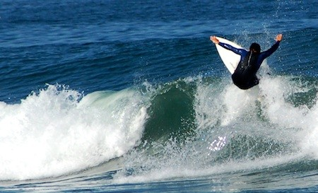 Local surfers worry that good will they've built up in the Cow Bay community will be wiped out by the O'Neill Cold Water Classic.