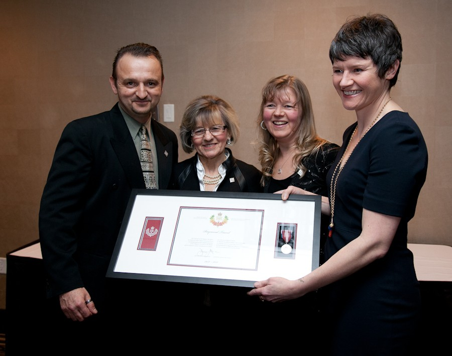 Megan Leslie presents Raymond Taavel's family with his Diamond Jubilee medal