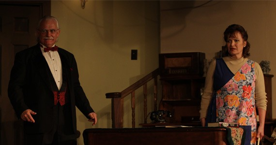 Monkswell Manor hostess Mollie (Bonnie Matthews) and the unexpected guest Mister Paravicini (Miles Leahy).