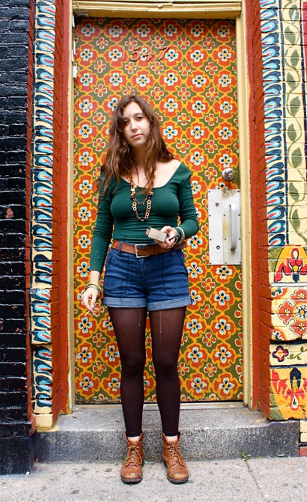 "Natasha rocks the high-waisted look---preferred over the low-rise by Haligonians in the know---and accessorizes with a leather belt and boots. ""All natural materials and adornments have been totally popular this year,"" she says. ""Take leathers and feathers for an example. I wonder how the cows and birds feel about this?"