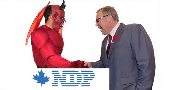 NDP premier Darrell Dexter as our Photoshop artists imagine him closing the deal to give Nova Scotian SAP jobs to IBM.