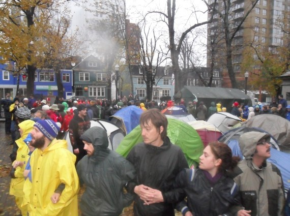 Occupy Nova Scotia demonstrators form a circle around their tents as a last stand against eviction.