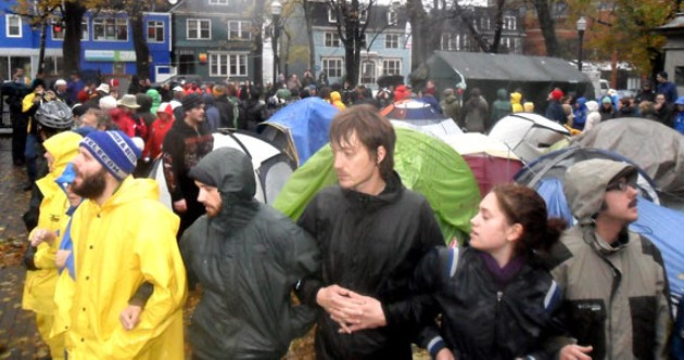 Occupy protesters non-violently resist eviction. - TIM BOUSQUET
