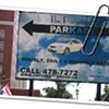 Paramount Apartments on South Park has a billboard in the middle of the sidewalk advertising its spacious parking lot.