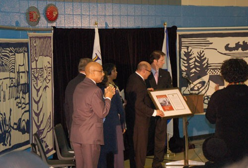 Peter Kelly presents Irvine Carvery, Africville Geoneology Society president, with the formal apology,