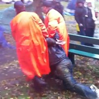 Police drag an Occupy Nova Scotia participant away.