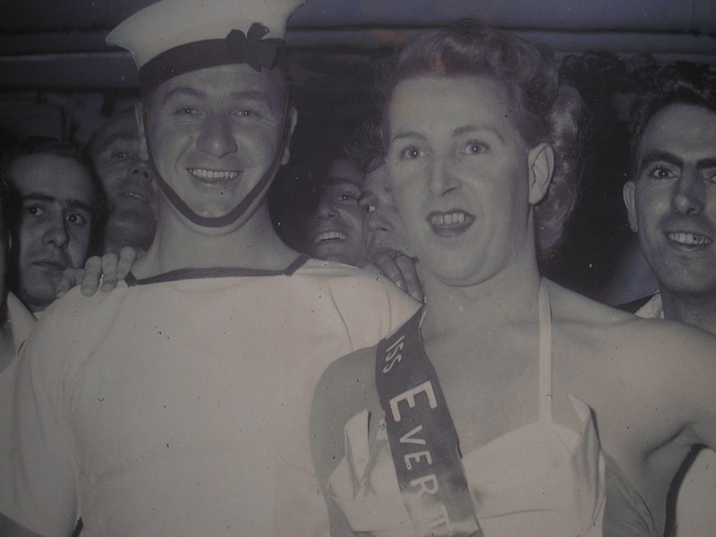 """Queen Mary crew members dress up, with """"Jane,"""" a steward from Liverpool - COURTESY OF ORAL HISTORY ARCHIVE AT SOUTHAMPTON CITY COUNCIL/OCEAN PICTURES/CUNARD"""