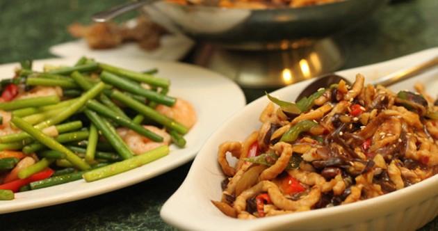 Shanghai noodles and garlic stalk with shrimp at 9 + Nine. - MELISSA BUOTE