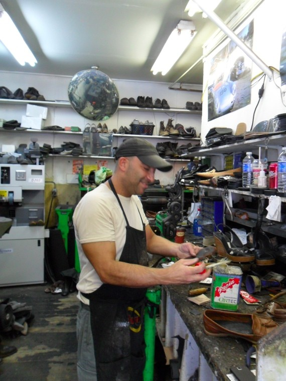 Shoe repairer Dimitri Christeas, hard at work.