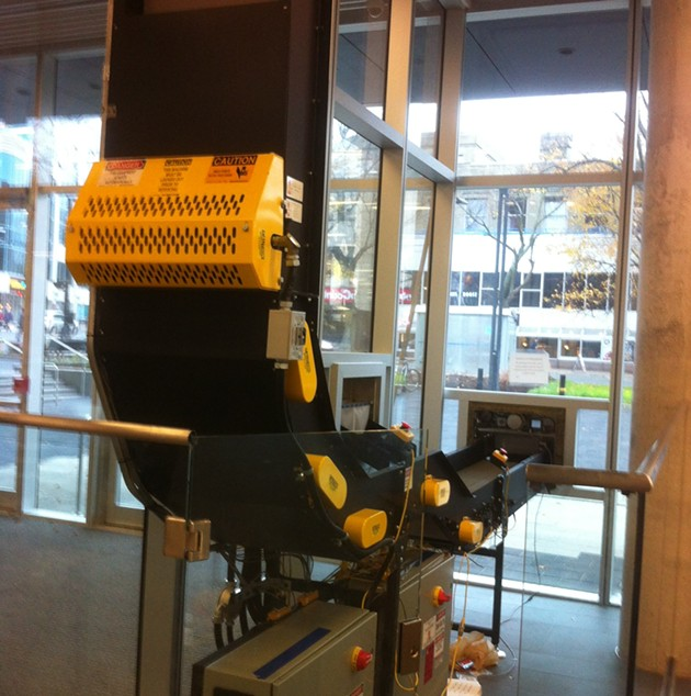 The automated book return system will be visible to those walking by.