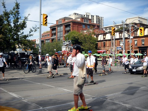Then I ran into this mob skateboarding through traffic on Queen Street. Not sure why.