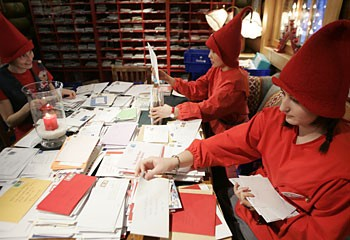 These Australian elves are sorting out the thousands of protest letters to be sent to the Canadian government this season.