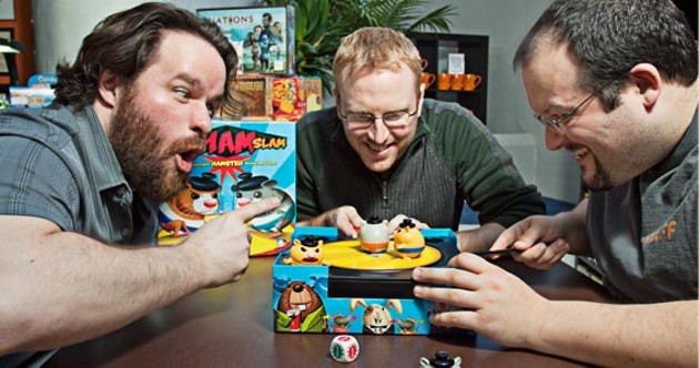 Things get heated with (l-r) Jon-Paul Decosse, Kris Moulton and John Gallant of the Board Room Game Cafe. - LENNY MULLINS
