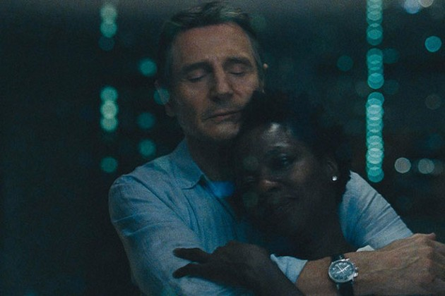 Neeson and Davis share a rare moment of levity in Widows. - SUBMITTED