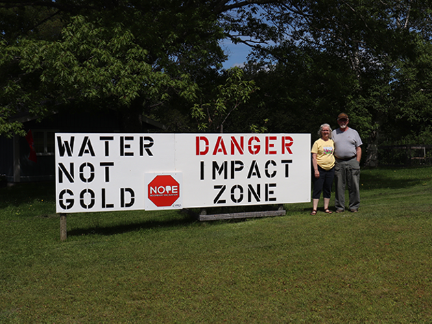Ralph Jack and Gwyneth Boutilier live on Cumminger Lake, below the proposed Cochrane Hill mine site, so they make their feelings about gold mining known on their front lawn. - ANDREW BETHUNE