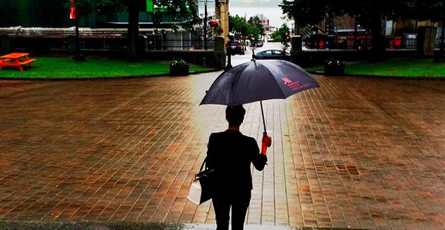Amanda Forrest, principal designer for The Marilyn Denis Show tours Grande Parade in the rain. - VIA INSTAGRAM.