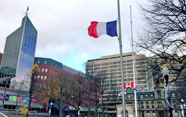The French flag flies at half-mast in front of City Hall last week. - VIA MIKE SAVAGE