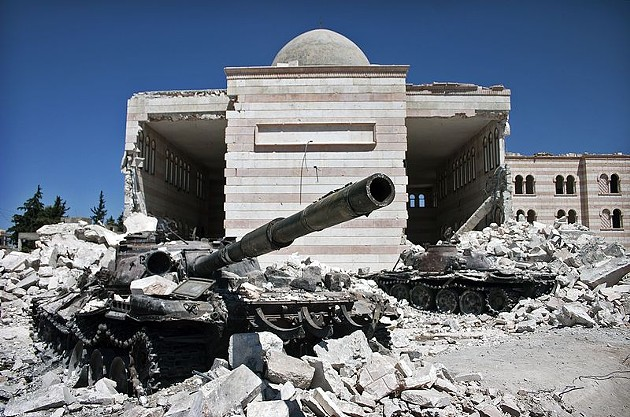 Two destroyed tanks in front of a mosque in Azaz, Syria, the site of a 2012 battle in the ongoing Syrian civil war. - VIA CHRISTIAAN TRIEBERT