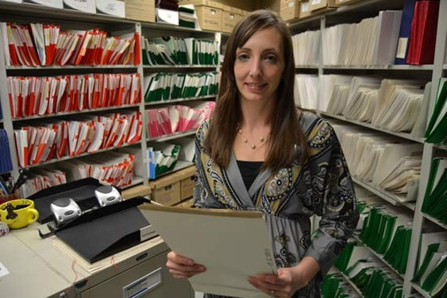 Melissa Mosher stands in front of the many files at the Residential Tenancies office in Halifax. - CHRIS MUISE