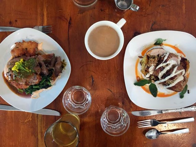 Two hearty Flying Apron meals, pork loin and lamb roast.