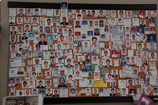 Some of the seafarers who've visited Halifax over the years, preserved as photos on this wall inside the mission. - ASHLEY CORBETT