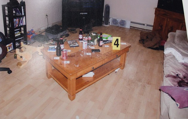 This photo exhibit from the trial shows the murder scene at John Lively's house, with bloody couch at right.