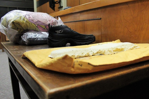 Police introduced a size 12 shoe as evidence, along with the casting (foreground) of a footprint from the murder scene. Jimmy Melvin Jr. wears size 12; Derek MacPhee is 10.5 or 11.