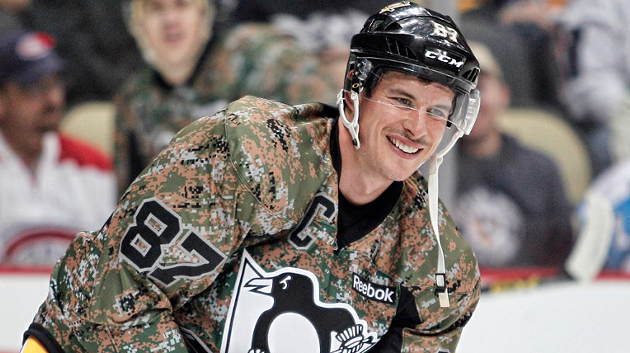 Pittsburgh Penguins captain Sidney Crosby wearing a camo jersey to honour military veterans during a hockey game last November. - VIA NHL.COM