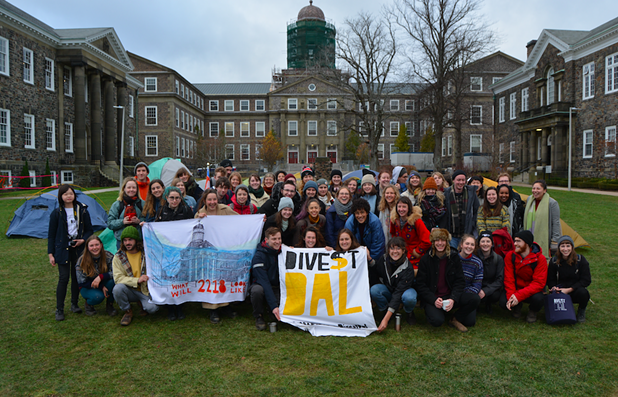 Alex Ayton is a Divest Dal committee member, pictured here with other Dalhousie students protesting on the quad. - VIA SAHAR ATBAEI