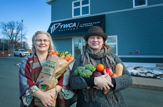 Spyfield market coordinator Twyla Nichols and Mobile Food Market client and volunteer, Kim O'Connell - LENNY MULLINS