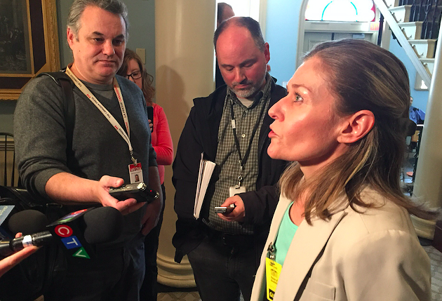Michelle Coffin speaks with reporters after Thursday's press conference. - MAGGIE RAHR