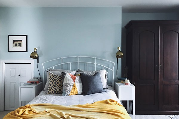 """We wanted something more minimalist in the bedroom that would have less of a footprint, a way to save space, so we put sconce lighting on the wall so the bedside table can be smaller but still pile your crap—adorably pile your crap."""