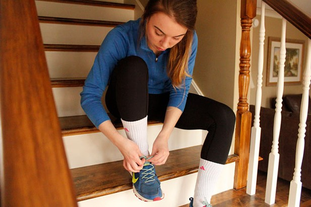 Lauren Goodyear laces up her shoes for a run. - JESSICA BRIAND