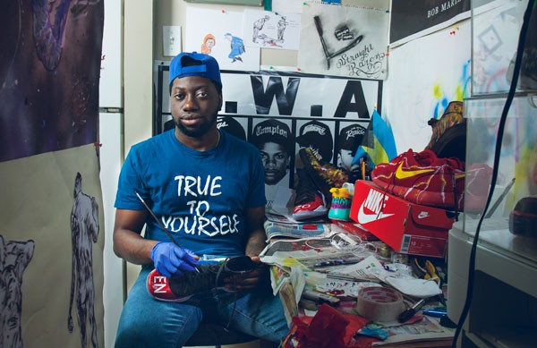 Kemmy Smith is running down a dream with his hand painted shoes. - LENNY MULLINS