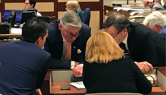 CAO Jacques Dubé (centre left) consults with planning staff and legal director John Traves in the middle of Tuesday's meeting. - THE COAST