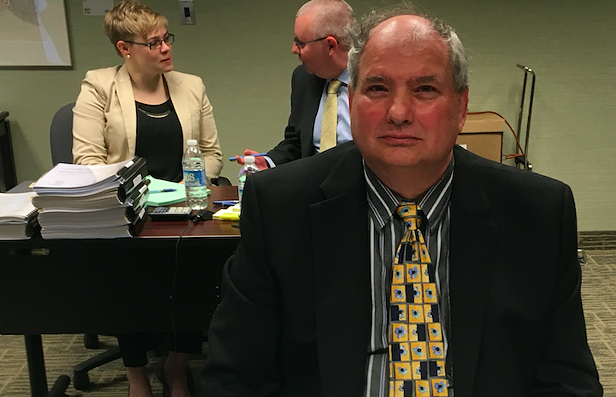 HRM lawyer Randolph Kinghorne at the hearing for damages and remedies. Behind, Human Rights Commission counsel Jason Cooke and Jennie Pick. - SANDRA C. HANNEBOHM