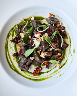 Black olive gnocchi with roasted shallot, sun dried tomato, goat cheese and pumpkin seed pesto - JESSICA EMIN
