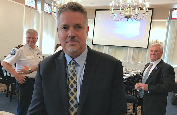 Scot Wortley, flanked by deputy chief Robin McNeil (left) and board of commissioners former chair Steve Craig (right), when he was hired, 17 months ago. - THE COAST