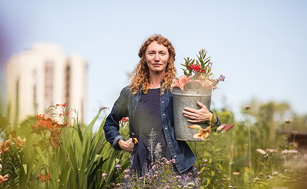Jayme Melrose, Common Roots Urban Farm's business developer stands in the farm's soon-to-be former home. - RILEY SMITH