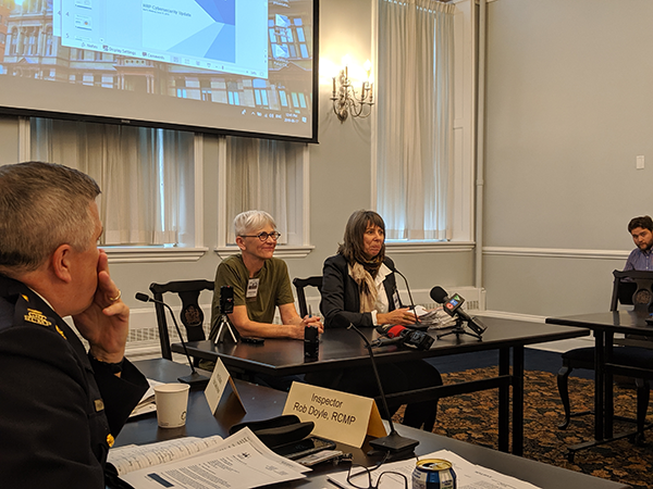 Joanne Bealy and Nancy Hunter (right) present The Coalition to Ban Street Checks' petition for the province to Halifax's Board of Police Commissioners. - SUBMITTED