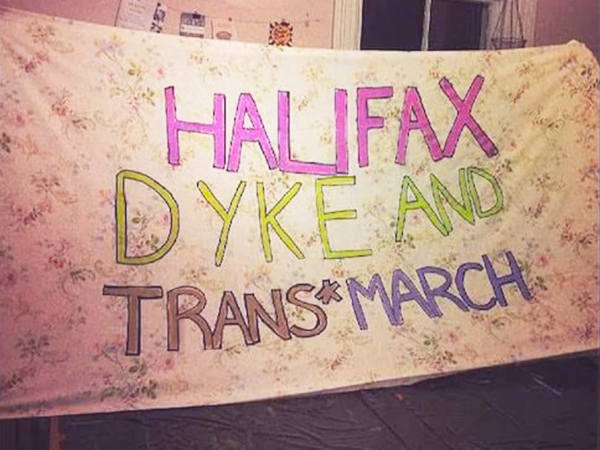A banner from a previous Dyke and Trans March in Halifax - RAD PRIDE'S FACEBOOK